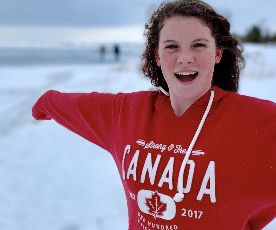 girl in a red Canada sweatshirt