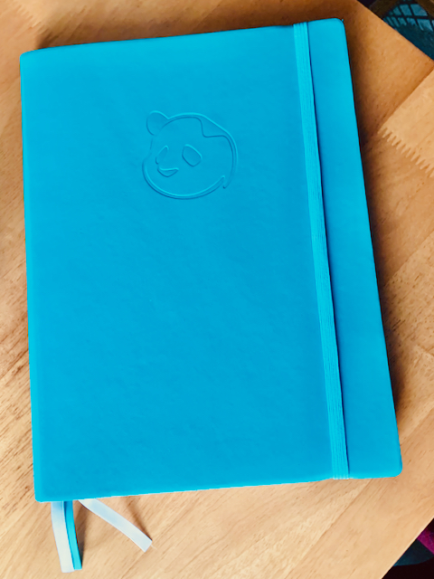 Blue softbound notebook, letter size, with an imprint of a panda and three ribbon bookmarks.
