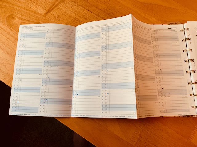 """A fold-out planner page labelled """"2022 Vertical Year Planner"""" from filofax."""