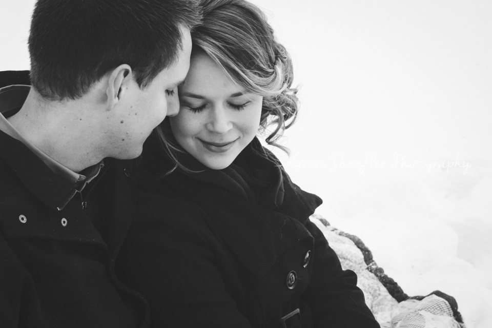 engaged couple in the snow