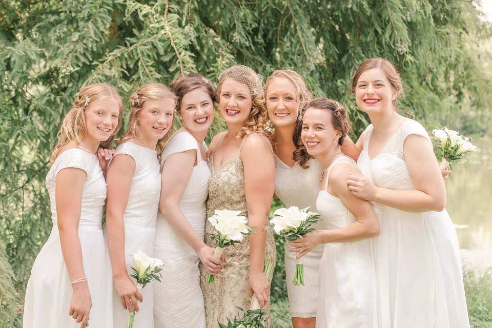 Bride in BHLDN gown and Bridesmaids in white at Audubon Park by Travel Wedding Photographer Karen Shoufler