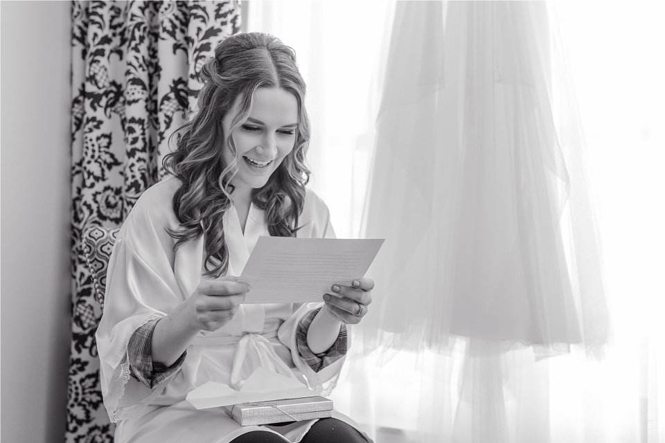 Bride reading letter from groom in Presidential Suite at the Doubletree in Springfield, Illinois