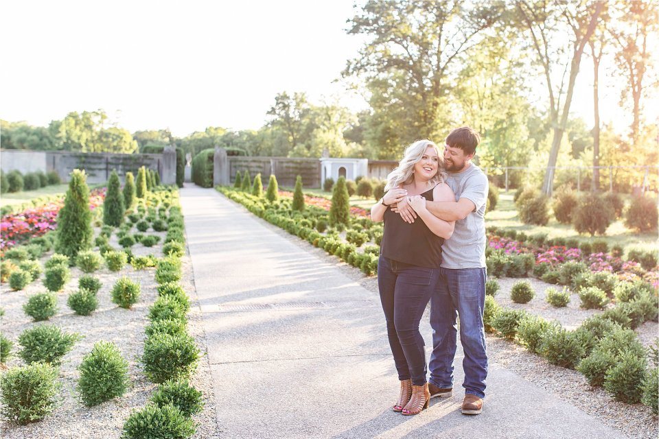 Couple smiling in gardens during engagement session at Allerton Park in Monticello, Illinois | Karen Shoufler Photography