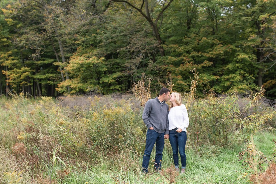 Stylish Couple in the tall grass in the fall at Morton Arboretum Engagement Photography by Karen Shoufler