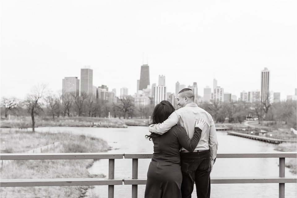 Winter engagement session at Nature Boardwalk at Lincoln Park Zoo in downtown Chicago with skyline view