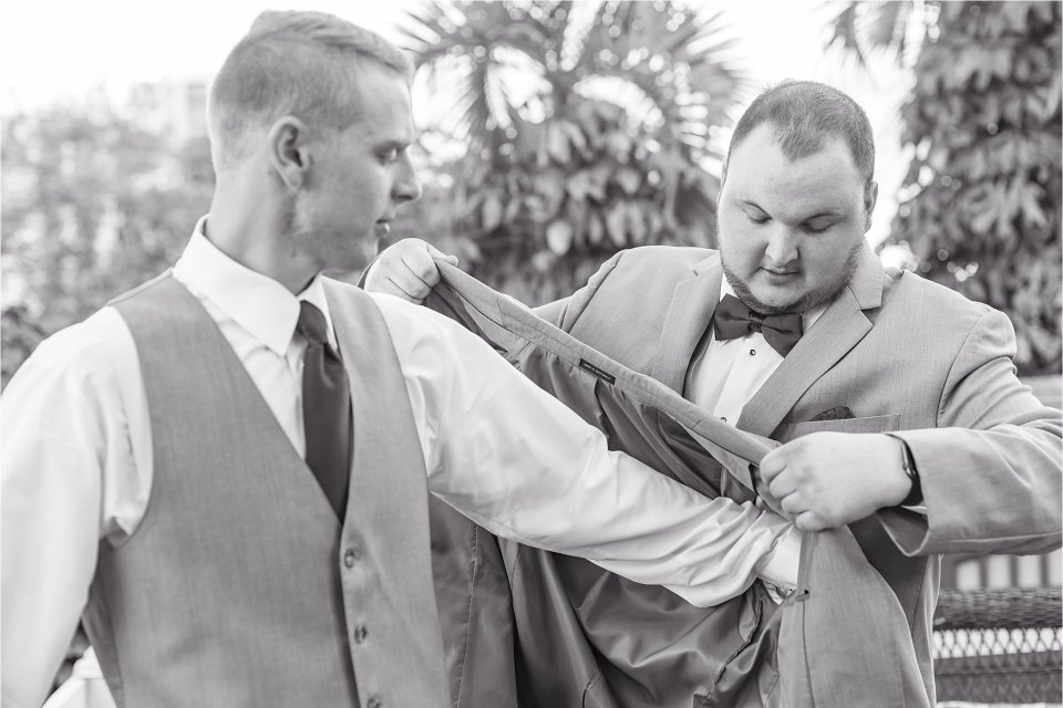 Groom getting ready at Heitman House wedding venue in Ft Myers, Florida