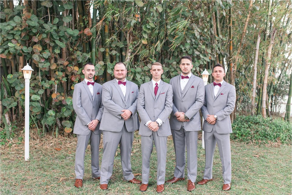 Groom and groomsmen at Heitman House wedding venue in downtown Ft Myers, Florida