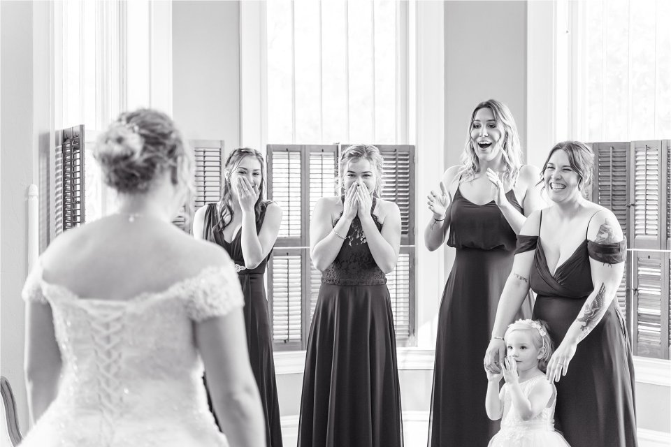 Bride reveal to bridesmaids at Heitman House wedding in downtown Ft Myers, Florida