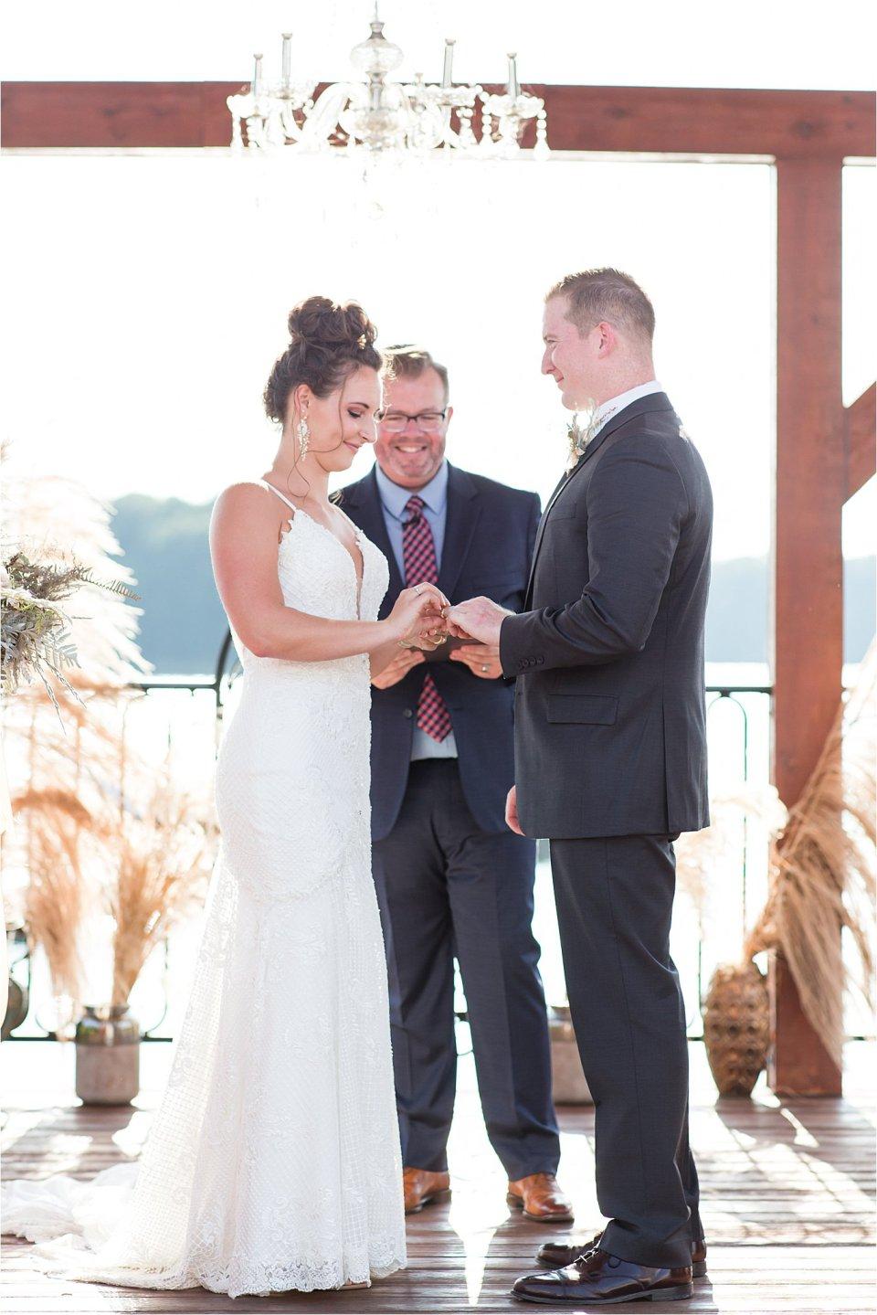 bride putting ring on groom during Egyptian Hills Resort wedding