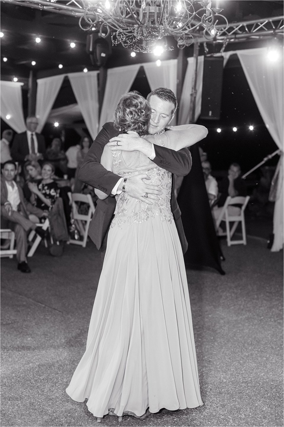 Groom and mother dancing at outdoor wedding Egyptian Hills Resort