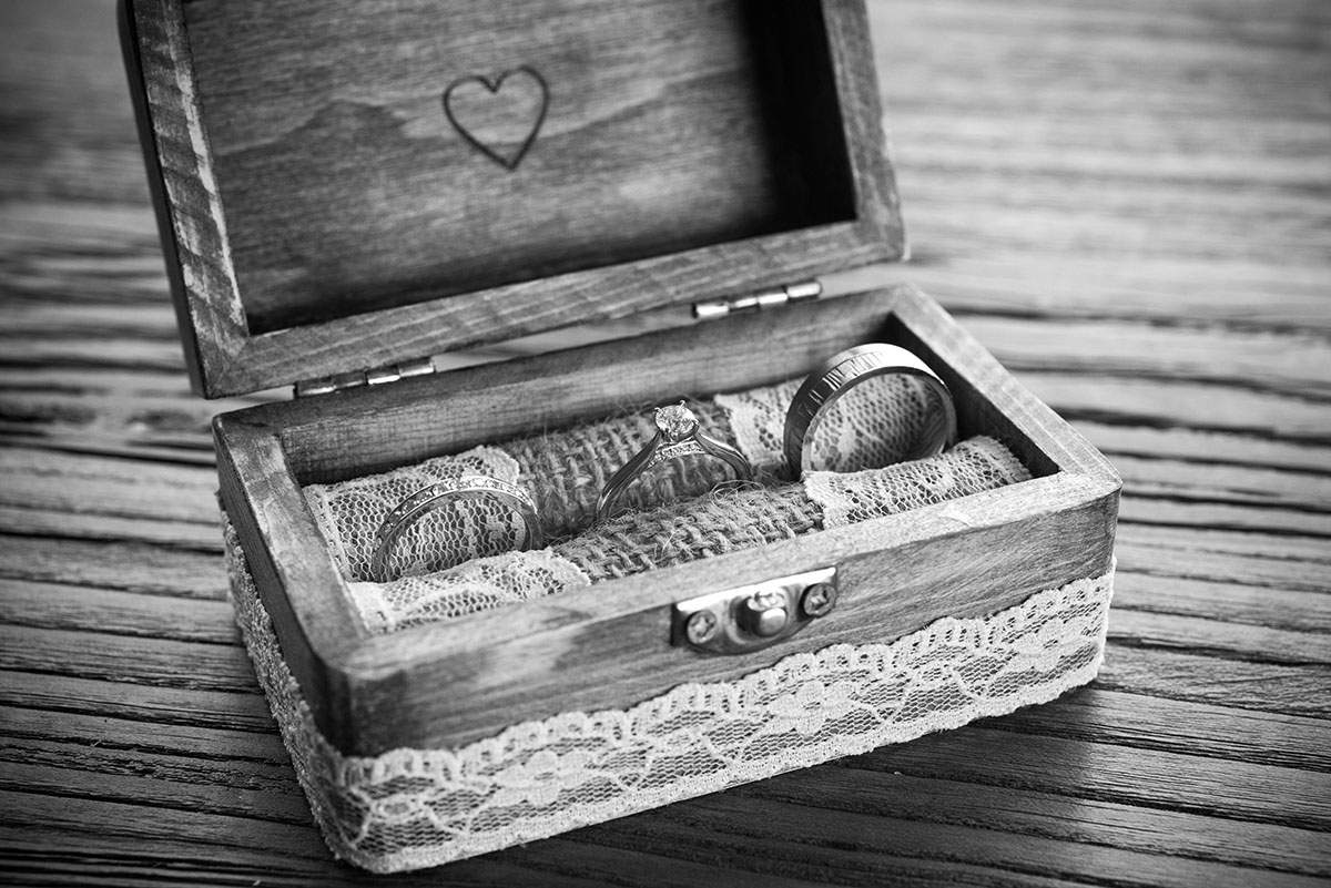 Wedding pictures - wedding rings and an engagement ring in a wooden box lined with lace and engraved with a love heart