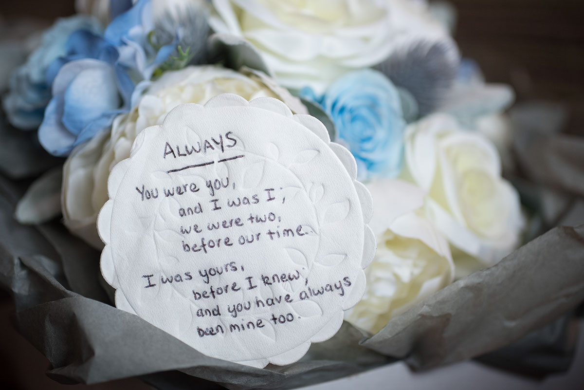 Wedding pictures - cream and light blue wedding flowers with a short poem entitled 'Always' written on a round piece of paper