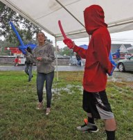 Swordfighting in the Lion's Club tent.
