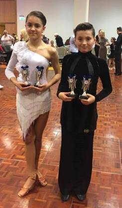 Eoin and Cezara with their first trophies together!