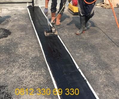 pekerjaan pemasangan asphaltic plug joint jembatan
