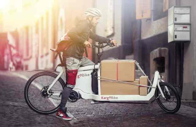 coursier à vélo kargobike valais lausanne mobilité durable livraison transport
