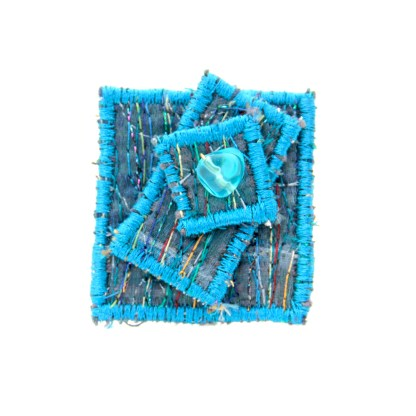 Reborn brooch from upcycled materials
