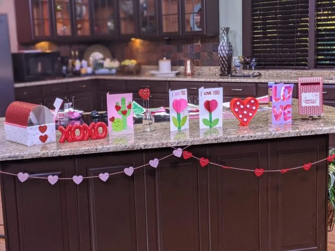 Valentines Day DIY crafts displayed on a table