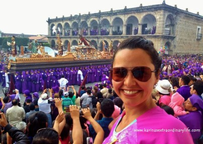 Karina stands tall to see over the crowd, admiring the San Bartolo procession march through the Parque Central. Antigua, Guatemala -- April Beresford