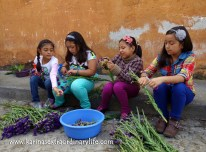 Second Grade girls work on the flowers for the alfombra collaboration. Antigua, Guatemala -- Karina Noriega