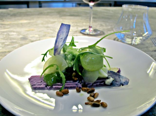 Pommes confites et crues, vitelotte, roquette, granité marjolaine. Candied and raw apples, purple vitelotte potato, salad rocket, marjoram granita.