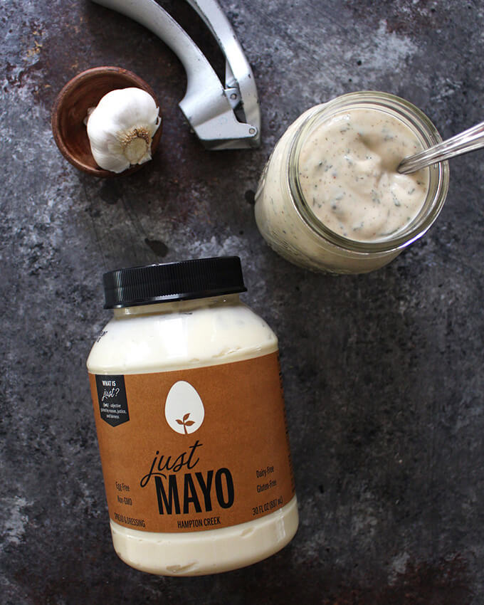 A container of just mayo alongside a jar of freshly made egg-free, vegan ranch.