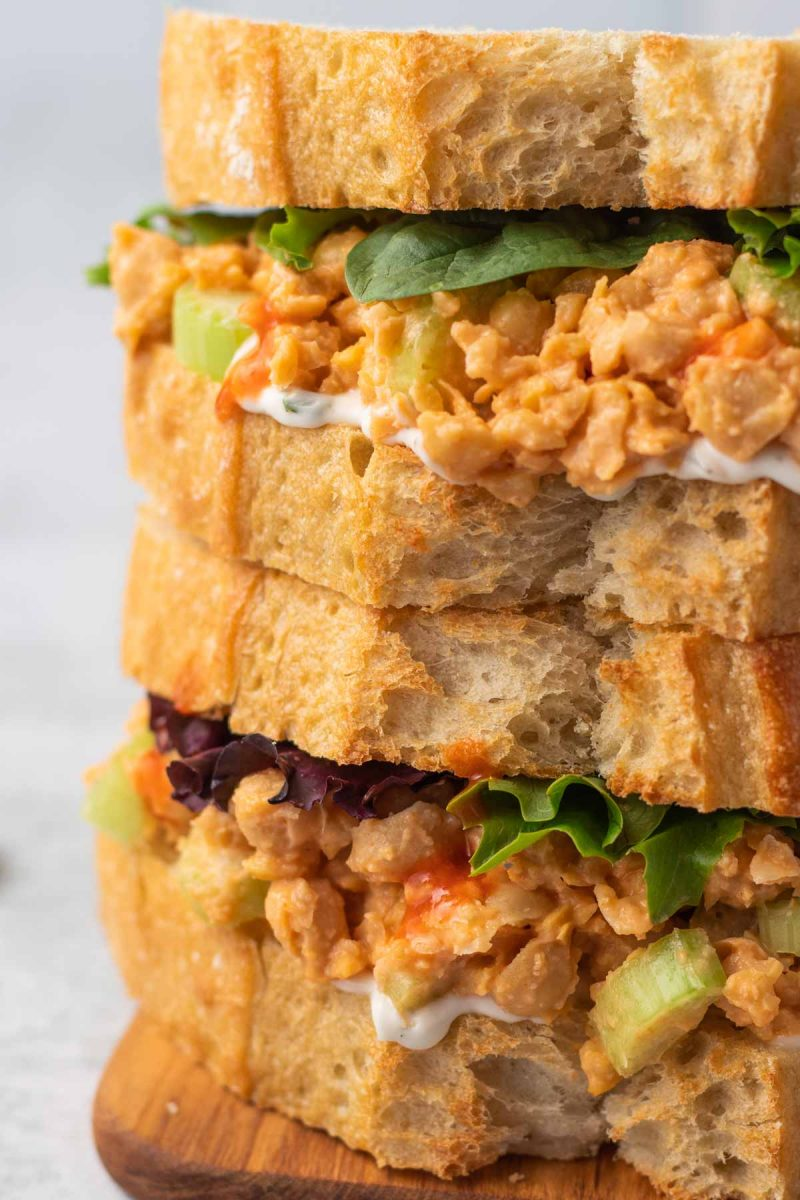 Spicy chickpea salad sandwiches with lettuce.