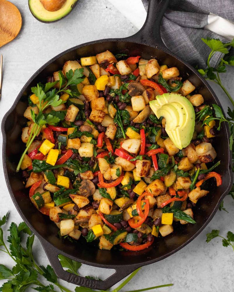 overhead of a large cast iron skillet with vegan breakfast hash