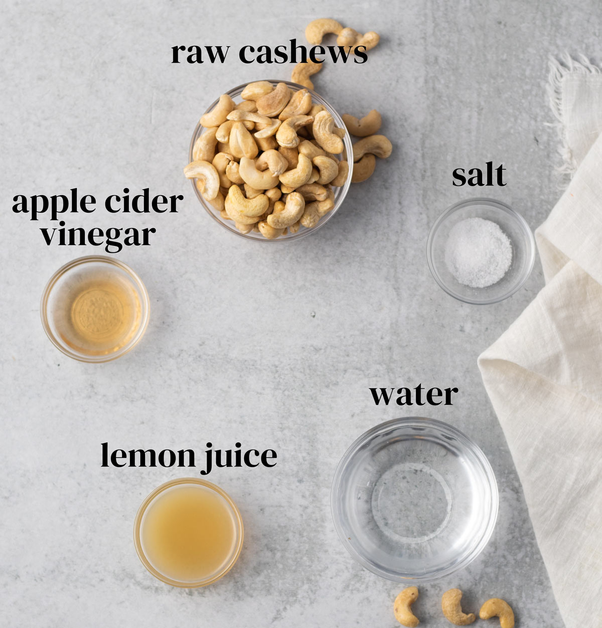 Ingredients for making vegan sour cream (cashews, apple cider vinegar, lemon juice, water, and salt.)