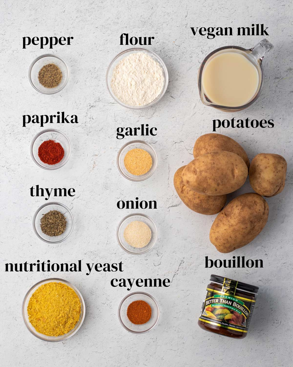 Ingredients for dairy-free scalloped potato casserole laid out on a surface.