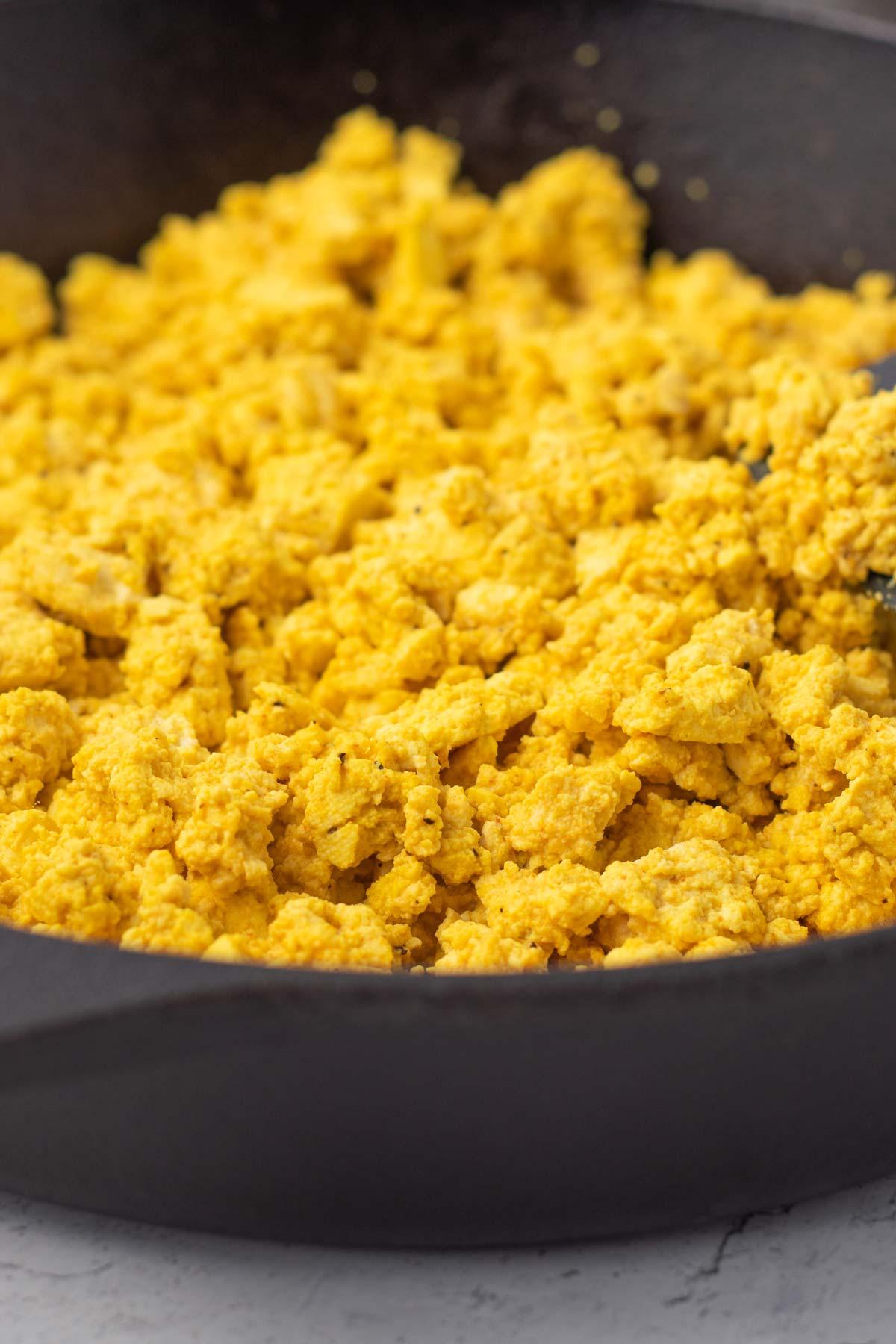 close up on scrambled tofu in a skillet