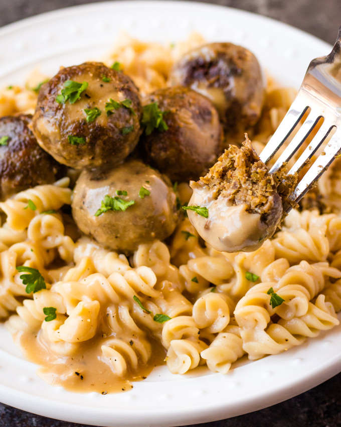 Vegan Swedish Meatballs served with a creamy gravy over top of pasta