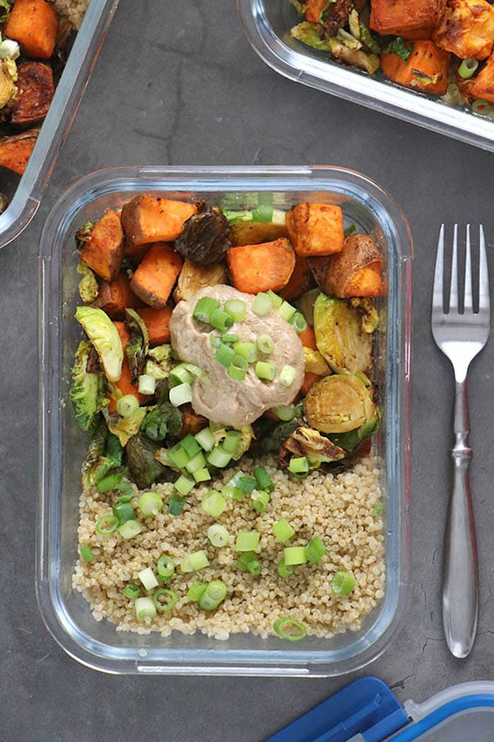 Vegan meal prep bowl with sweet potatoes, quinoa, veggies, and more.