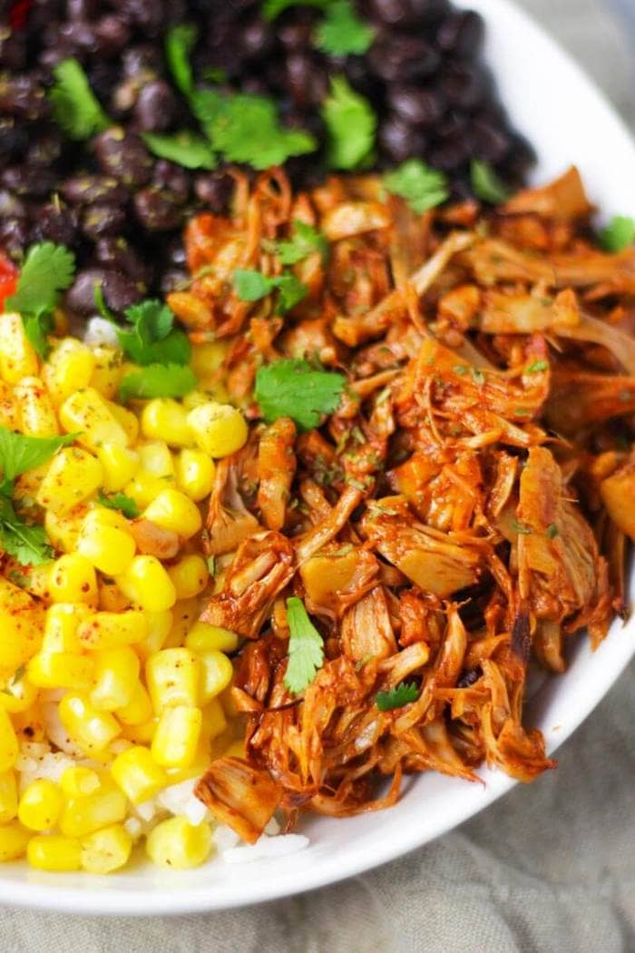 Jackfruit enchilada meal prep bowls with corn and black beans.