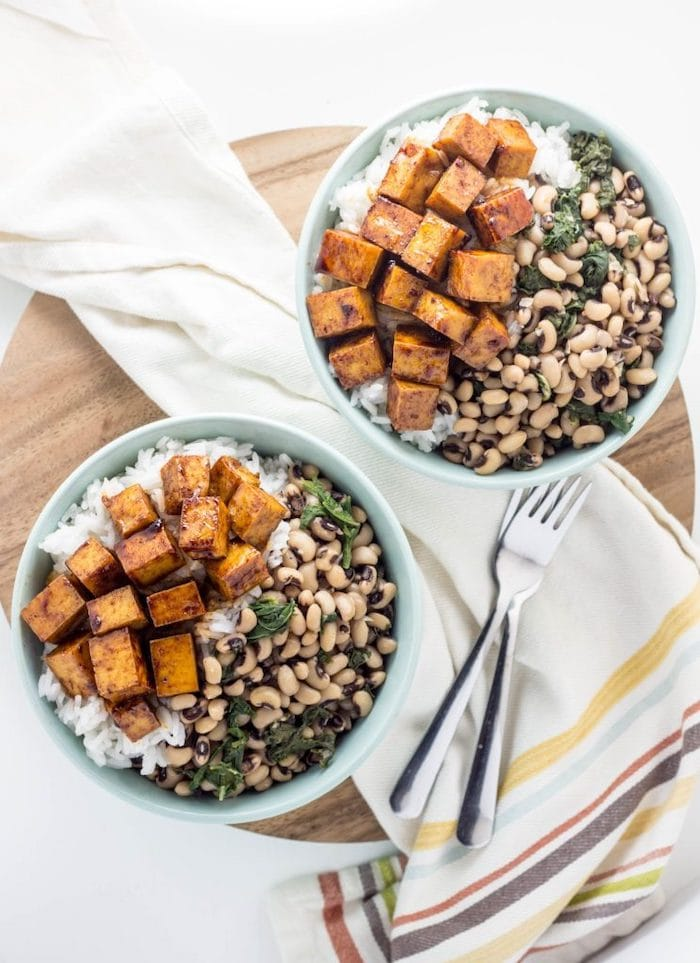 Vegan meal prep bowl with black eyed peas, rice, and tofu.