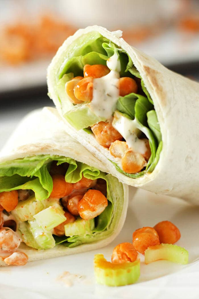 Meal prep buffalo chickpea wraps with lettuce and vegan ranch