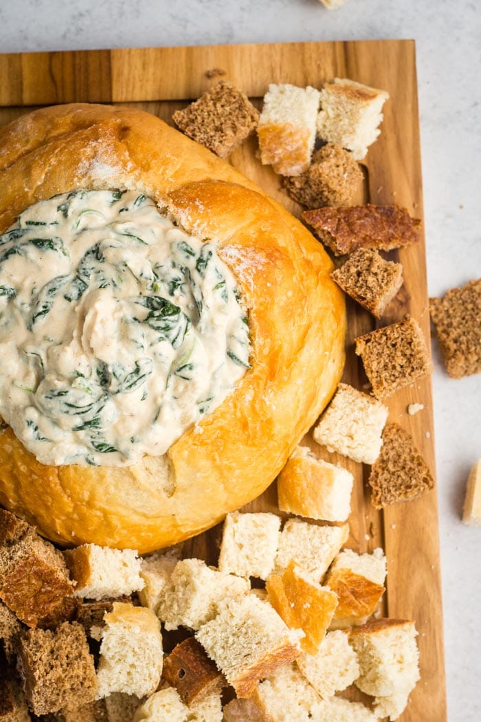 Cold vegan spinach dip in a bread bowl.