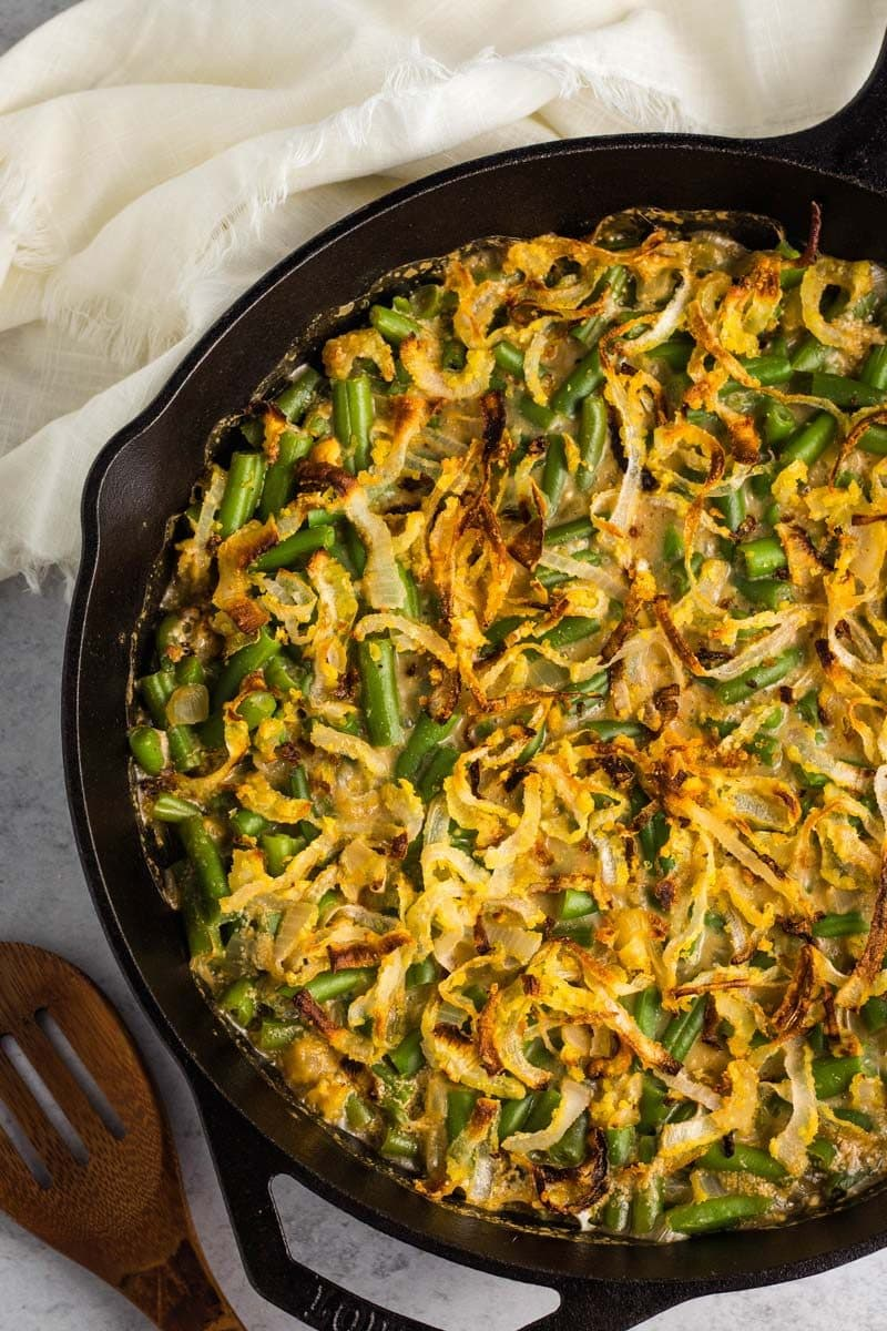 Vegan green bean casserole in a cast iron pan.