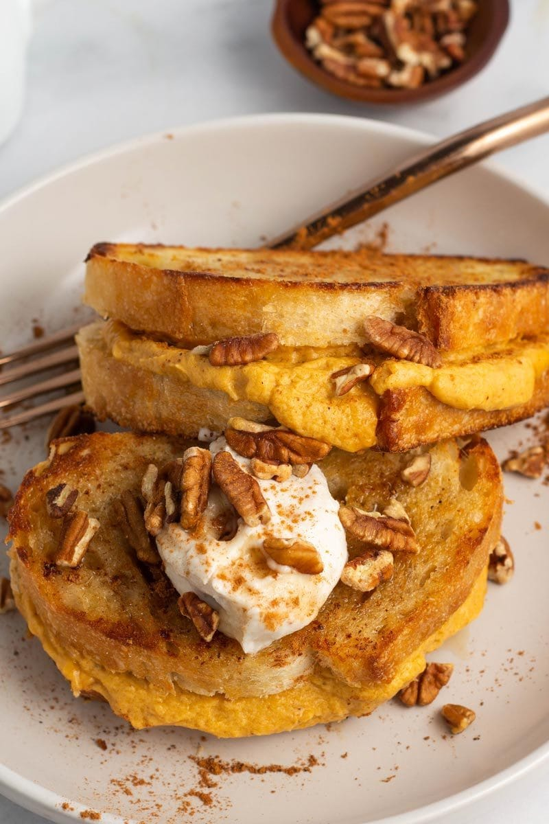 Vegan pumpkin stuffed french toast on a plate.