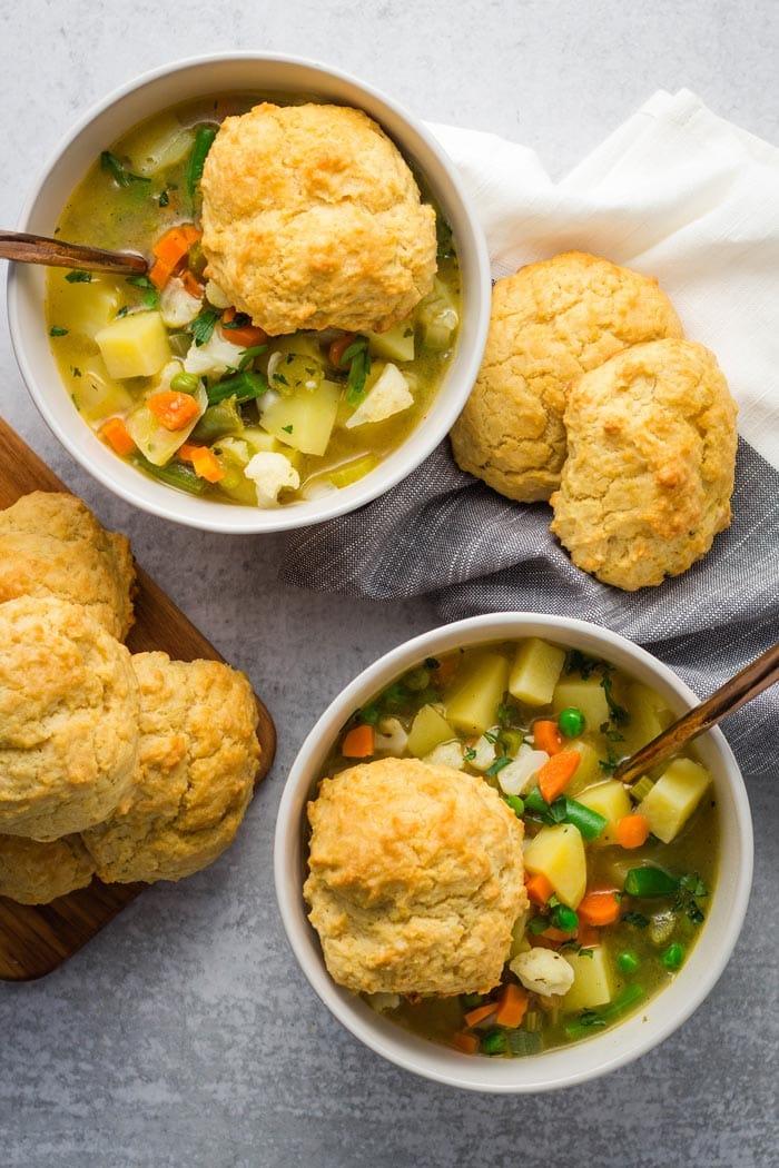 Vegetable pot pie soup with biscuits on top.
