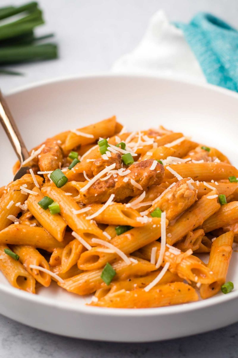 A bowl of vegan cajun pasta made with penne and vegan chicken.