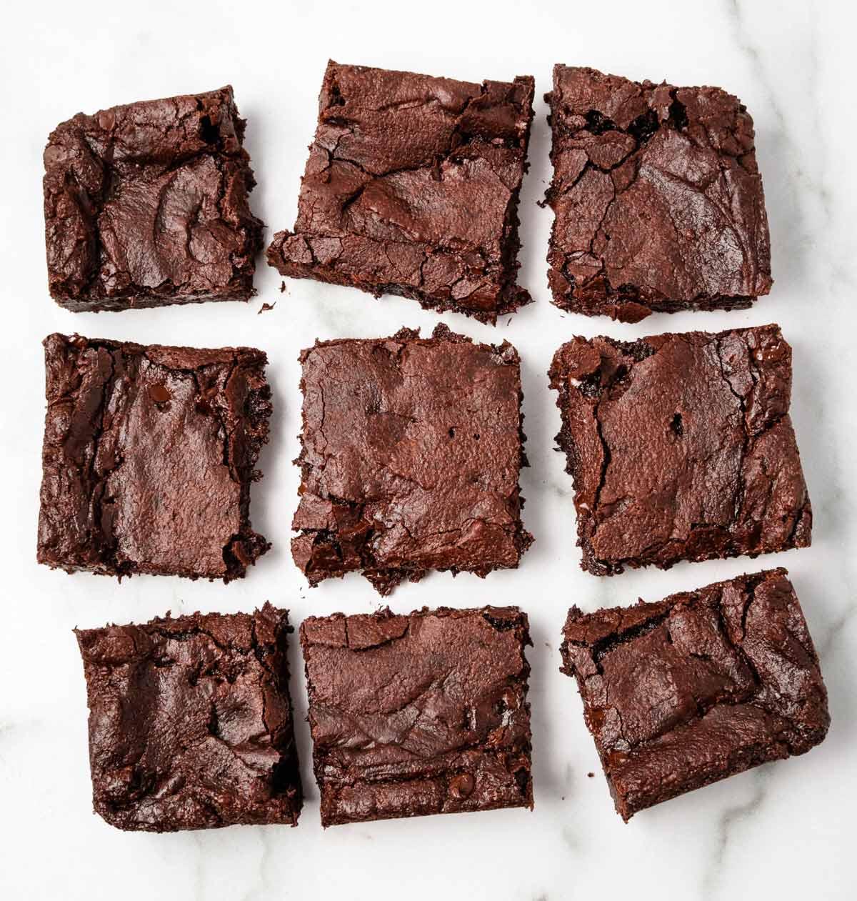 An above shot of vegan brownies cut into 9 squares.
