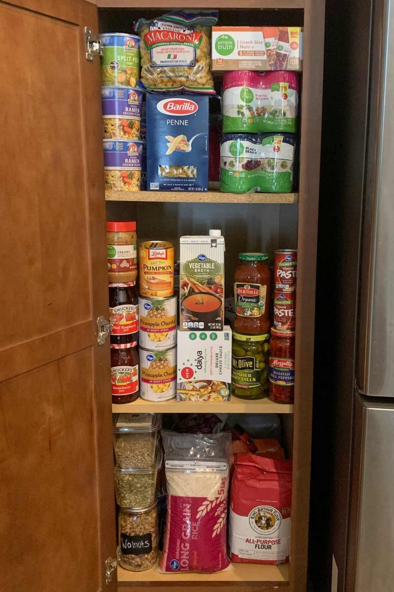 Pantry full of staples and emergency food: canned fruit, pickles, flour, nuts, tomato paste, pasta, and much more.