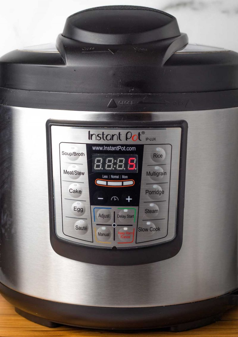 A head on shot of an Instant Pot, timer set to 5 minutes.