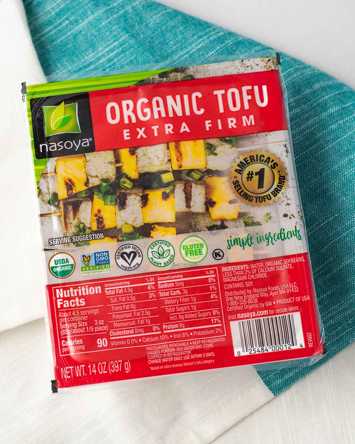 A package of Nasoya organic extra firm tofu.