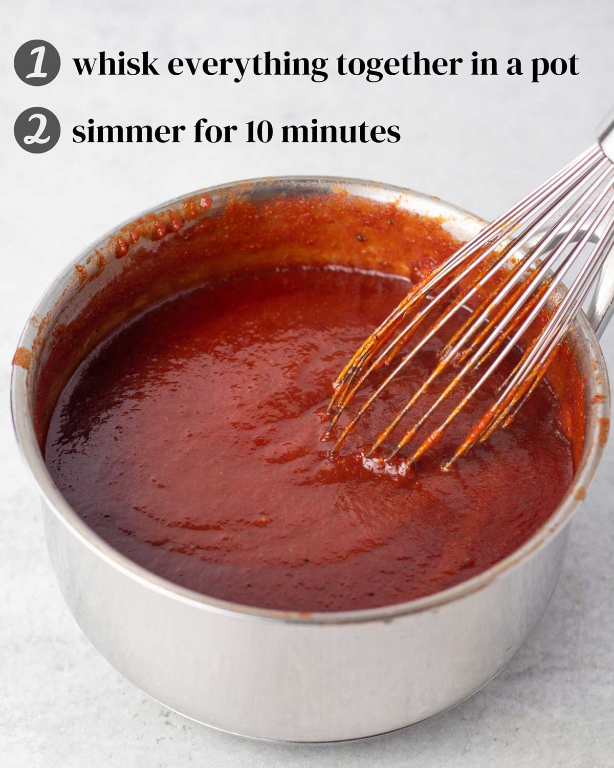 "Barbecue sauce in a sauce pan with a whisk. Writing reads: ""1) Whisk everything together in a pot. 2) Simmer for 10 minutes."""