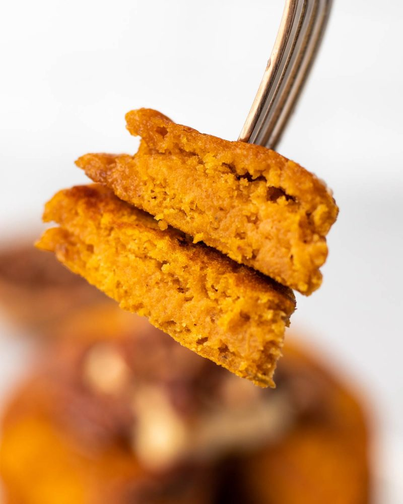 A bite of vegan pumpkin pancakes on a fork.