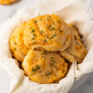 Cheddar biscuits in a basket.