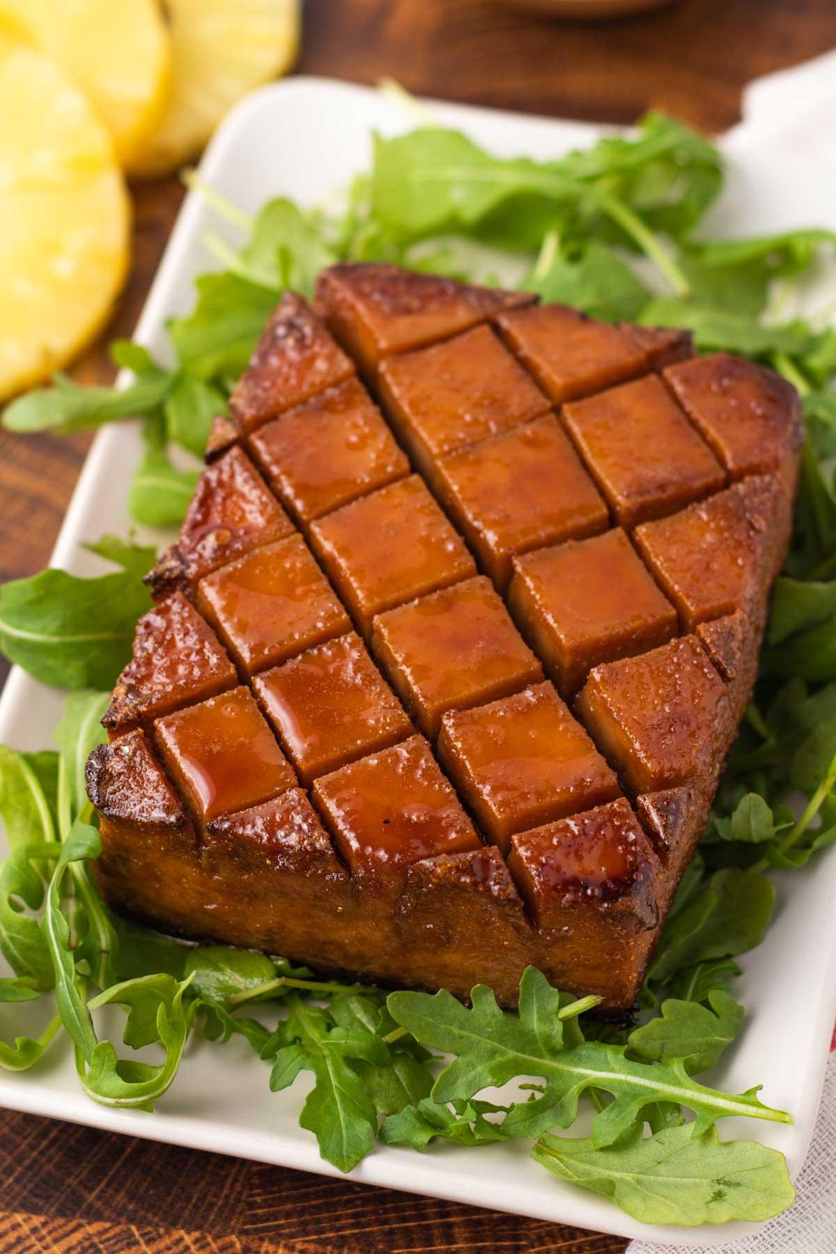 vegan holiday roast tofu with baby arugula on the plate
