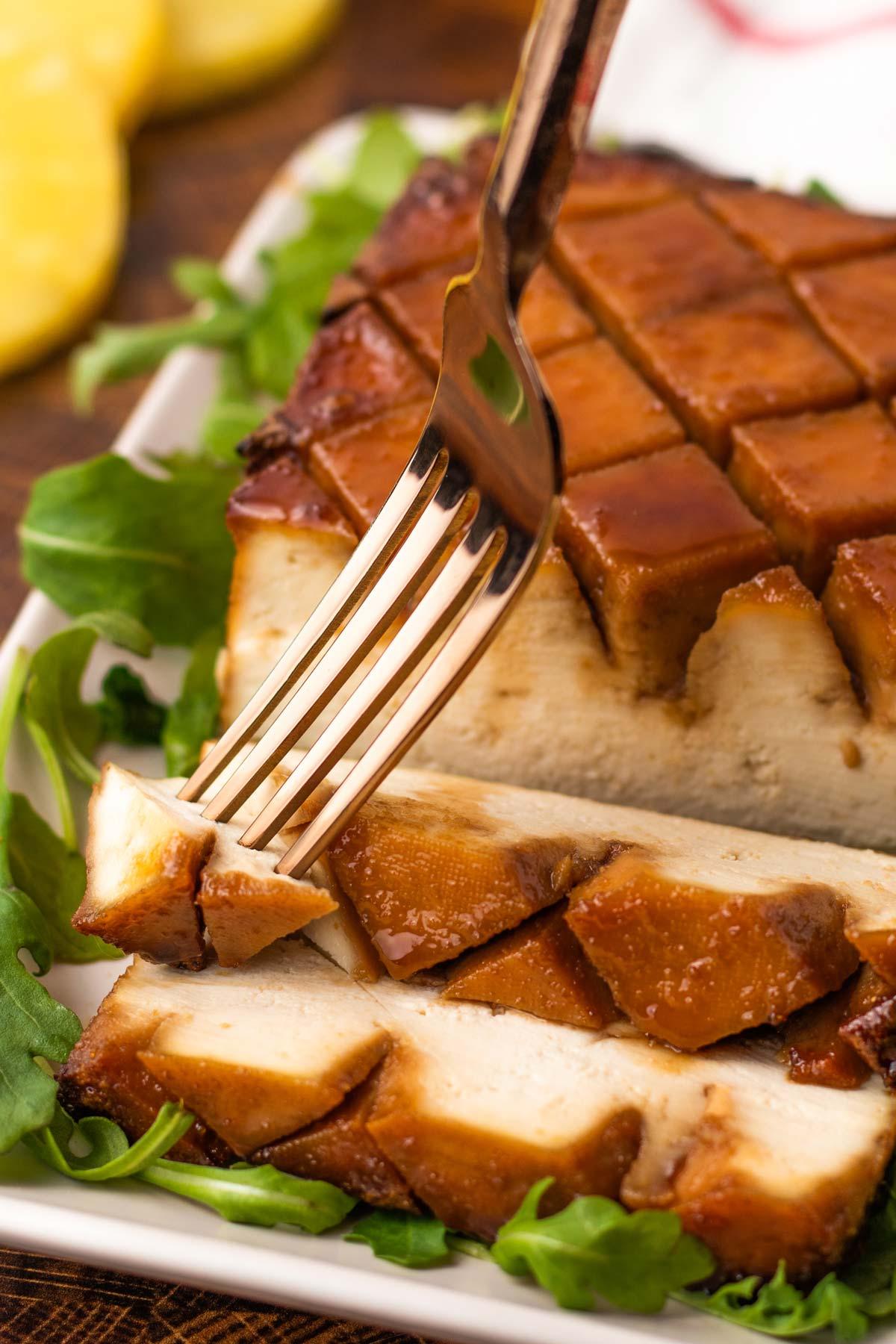 sliced vegan holiday roast with pineapple-soy glaze